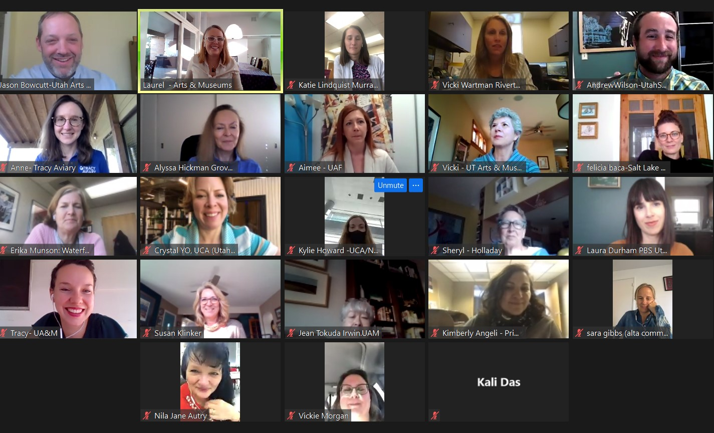 A screenshot of a Zoom video conference. The image contains a grid of square, each containing the image of a different individual.