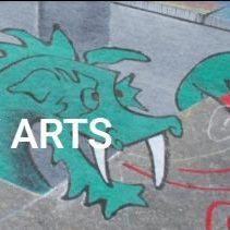"""Chalk art of a blue dragon with the text """"Community Arts."""""""