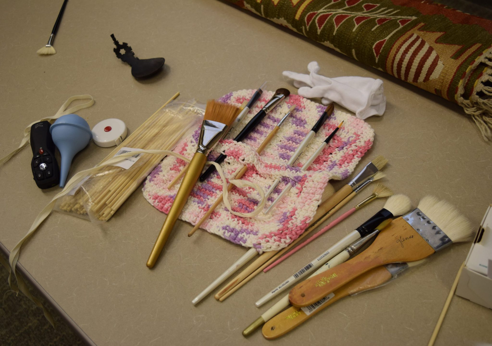 Brushes sit on a table.